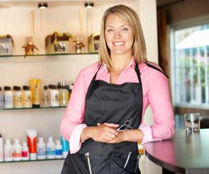 Woman working in hairdressing salon,QuickBooks® Consulting in and around Montgomery County, MD and Washington, DC and Virginia